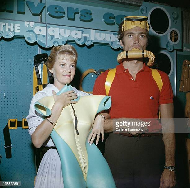 American actor Clint Eastwood and his first wife Maggie Johnson shopping for scuba diving equipment, circa 1960.