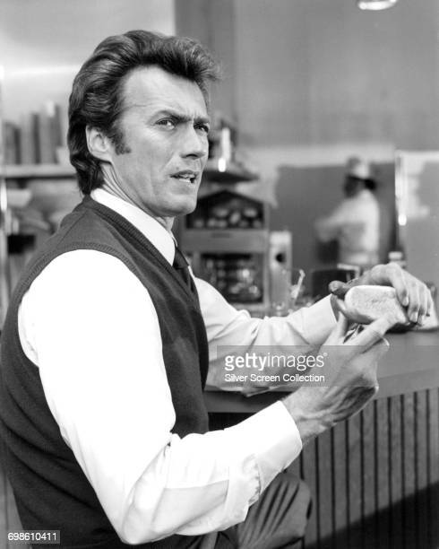 American actor Clint Eastwood as Police Inspector Harry Callahan eating a hot dog in the film 'Dirty Harry' 1971