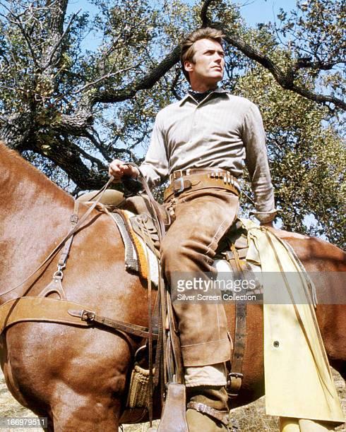 American actor Clint Eastwood as Rowdy Yates, on horseback, in the TV western series 'Rawhide', circa 1965.