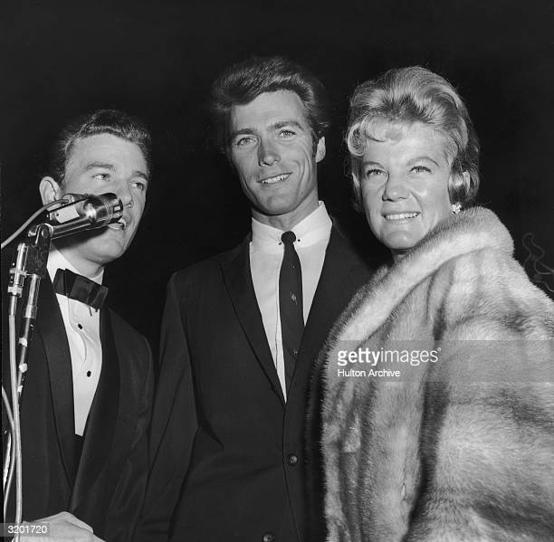 American actor Clint Eastwood and his first wife Maggie stand next to an unidentified announcer at the West Coast premiere of director Blake Edwards'...