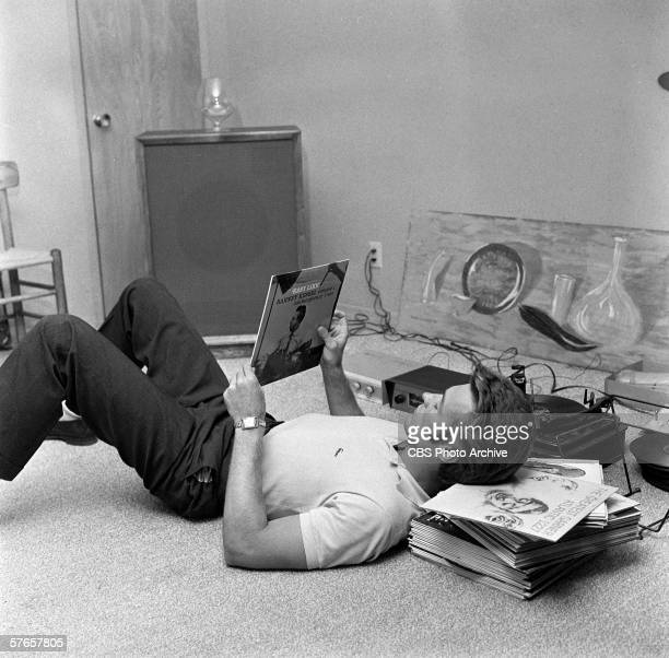 American actor Clint Eastwood listens to records at his home October 1 1959