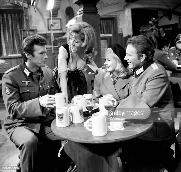 American actor Clint Eastwood newcomer Ingrid Pitt and British film stars Mary Ure and Richard Burton during filming of a South German beer cellar...