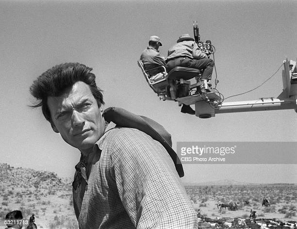American actor Clint Eastwood on location for 'Rawhide' stock cattle drive footage May 24 1963 The director and cinematographer sit on a crane behind...