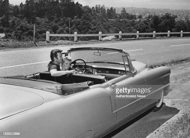 American actor Clint Eastwood with his first wife Maggie Johnson in a Cadillac convertible, USA, circa 1960.