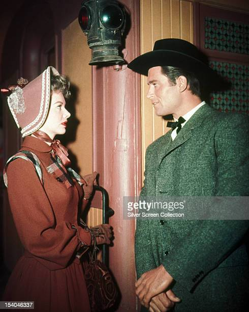American actor Clint Walker as Cheyenne Bodie with an unknown actress in an episode of the TV western series 'Cheyenne' circa 1960