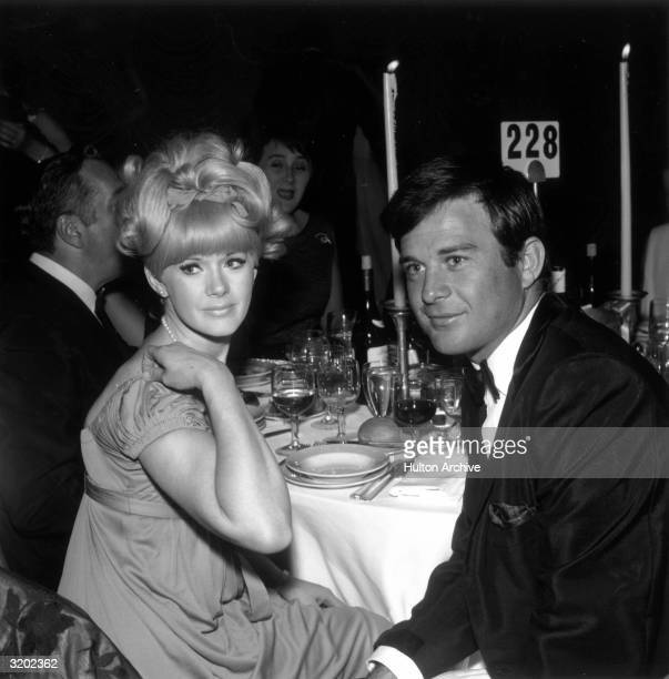 American actor Connie Stevens and her first husband American actor James Stacy sit at their table at the Screen Producer's Ball