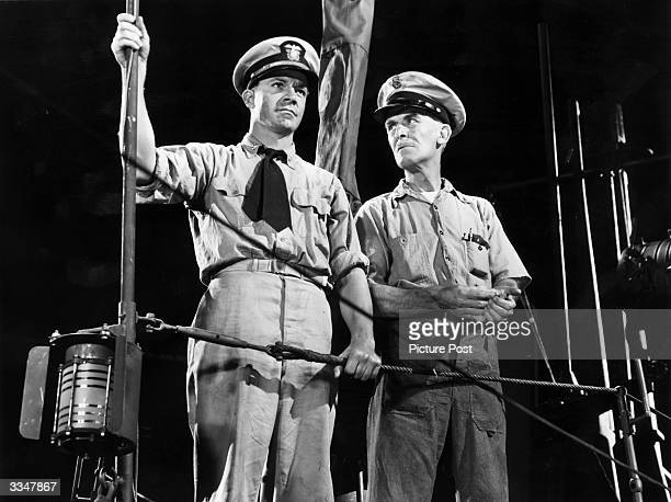 American actor Dana Andrews left and James Gleason star in the film 'Crash Dive' a wartime romance directed by Archie Mayo for 20th Century Fox