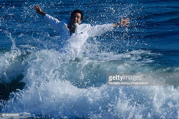 American actor Daniel McVicar plays in the surf on a Los Angeles beach.