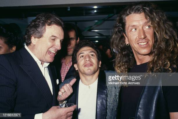 American actor Danny Aiello American boxer Ray Mancini and British guitarist Steve Jones attending an unspecified event circa 1985