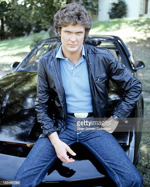 American actor David Hasselhoff star of the TV show 'Knight Rider' sitting on KITT the artificially intelligent supercar featured in the series circa...