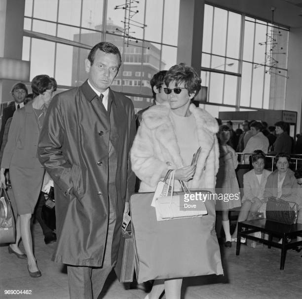American actor David Janssen with his wife fashion model and interior designer Ellie Graham at Heathrow Airport London UK 15th May 1967