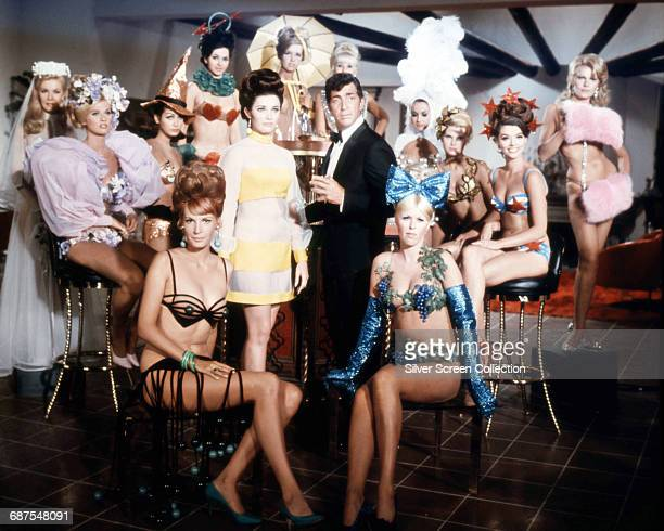 American actor Dean Martin as Matt Helm surrounded by his female costars in a publicity still for the film 'Murderer's Row' 1966 From left to right...