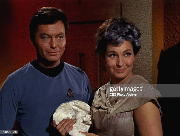 American actor DeForest Kelley as Dr Leonard 'Bones' McCoy and American actress Jeanne Bal as Nancy Crater appear in a scene from 'The Man Trap' the...