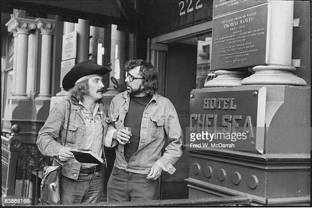 American actor Dennis Hopper and author Terry Southern talk on the front steps of the Chelsea Hotel New York New York September 30 1971