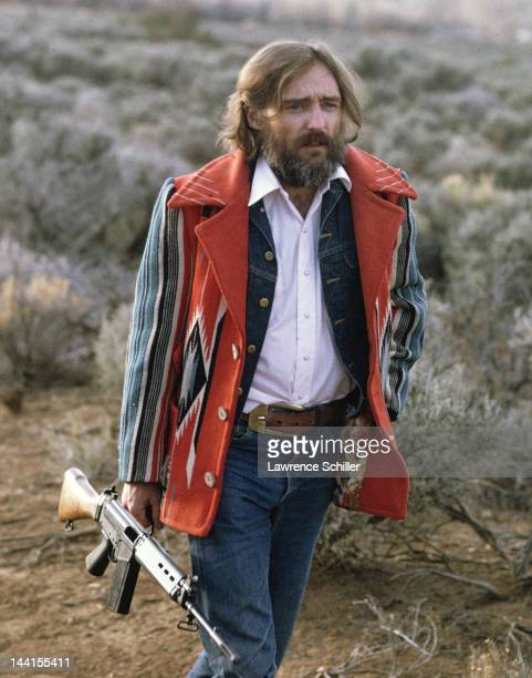 American actor Dennis Hopper carries a rifle during the filming of the documentary about him entitled 'The American Dreamer' Taos New Mexico August...