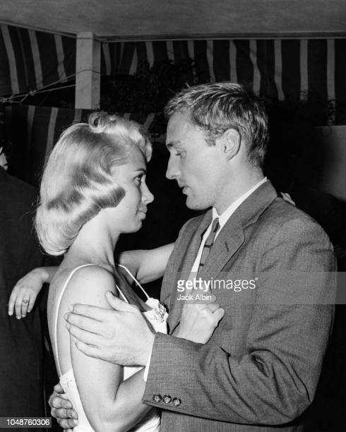American actor Dennis Hopper dancing with a young woman at a party given by Audra Martin in Los Angeles California 19th June 1957