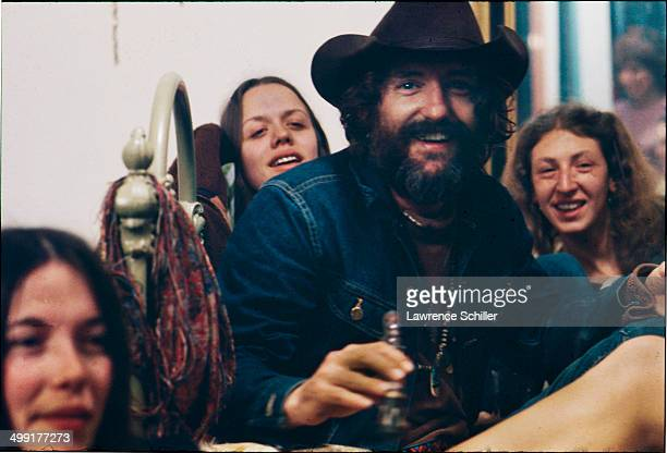 American actor Dennis Hopper sits with groupies and various hangerson in his home a wouldbe commune named the Mabel Dodge Luhan House during the...