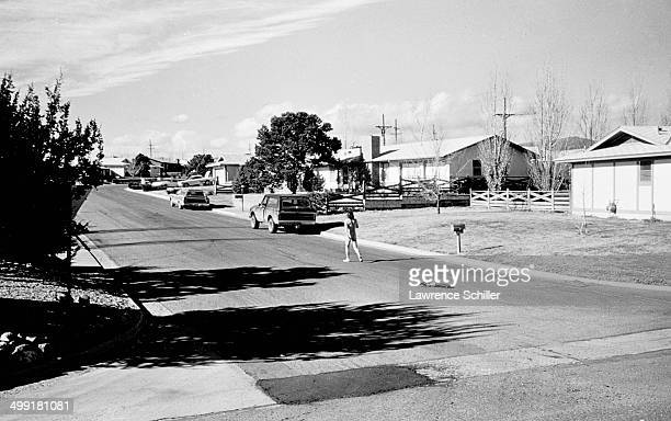 American actor Dennis Hopper walks naked down a suburban street during the filming of the documentary about him entitled 'The American Dreamer' Los...