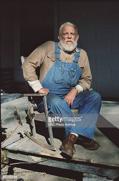 American actor Denver Pyle sits in a rocking chair on his porch in publicity still from the television series 'The Dukes of Hazzard,' 1979.