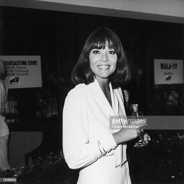 American actor Diana Rigg holds a glass at an NBC television network party, Hollywood, California, July 1973.