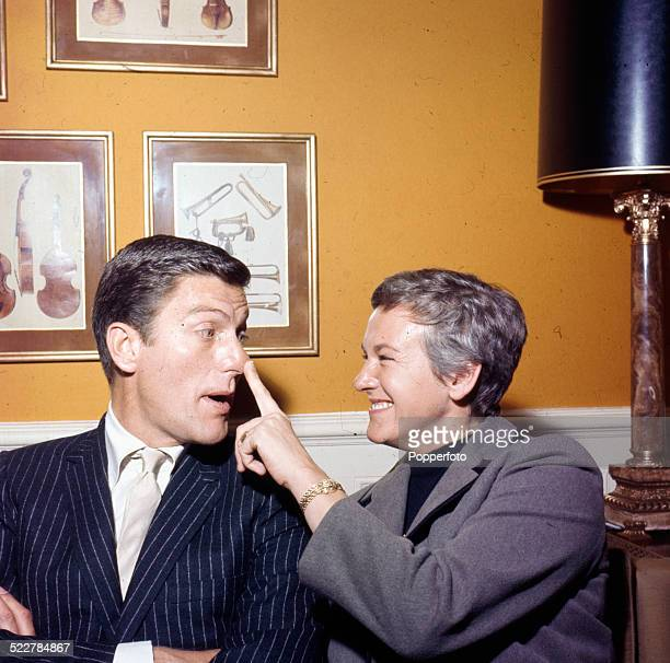 American actor Dick Van Dyke pictured with his wife Margie Willett in London in 1964