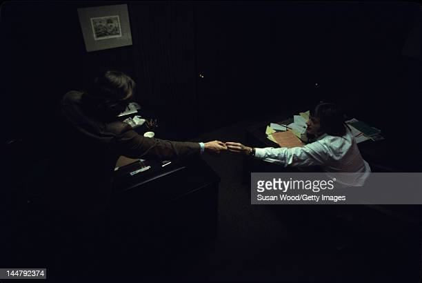 American actor director Dennis Hopper passes something to actor Peter Fonda during preparations for the filming of Hopper's directorial debut 'Easy...