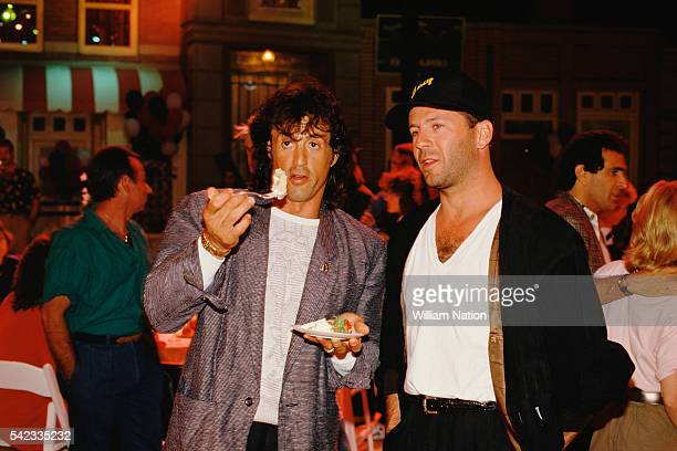 American actor director screenwriter and producer Sylvester Stallone and actor Bruce Willis attend Demi Moore's 30th birthday party at Six Flags...