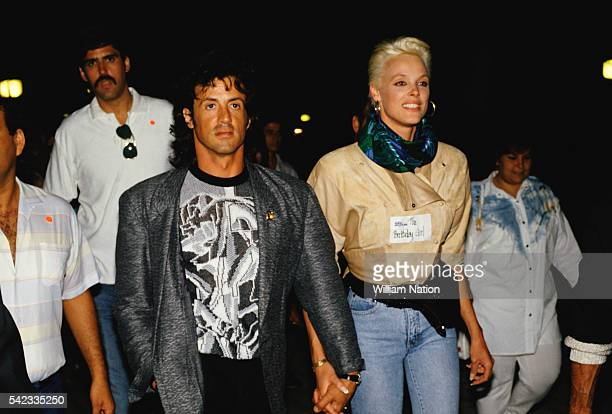 American actor director screenwriter and producer Sylvester Stallone and his partner Danish actress and former model Brigitte Nielsen attend Demi...