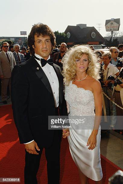 American actor director screenwriter and producer Sylvester Stallone and his wife Sasha Czack attend the premiere of the movie Rhinestone directed by...