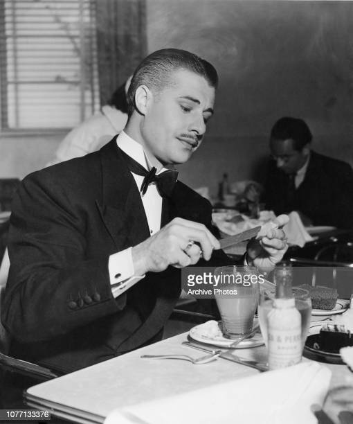 American actor Don Ameche in a restaurant 1938