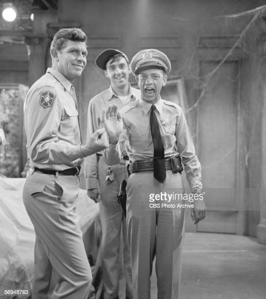 American actor Don Knotts waves to the camera while actor Andy Griffith clenches his fist and actor Jim Nabors smiles while on a break filming...