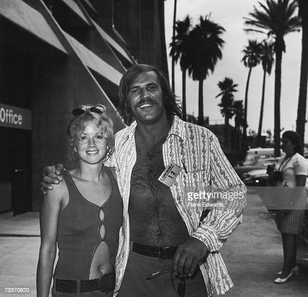 American actor Don Stroud with Sally Little at the California 500 Ontario Motor Speedway race, circa 1972.