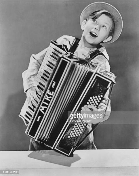 American actor Donald O'Connor playing the accordion aged 12 in 1938
