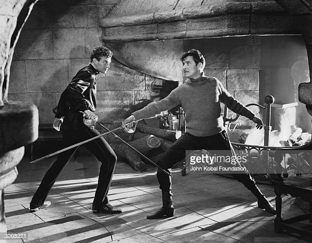 American actor Douglas Fairbanks Jr and Ronald Colman engaged in furious swordplay in a scene from the swashbuckling adventure 'Prisoner of Zenda'...
