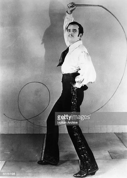 American actor Douglas Fairbanks Sr. Holding a whip in a promotional portrait for director Donald Crisp's film, 'Don Q, Son of Zorro'. Fairbanks...