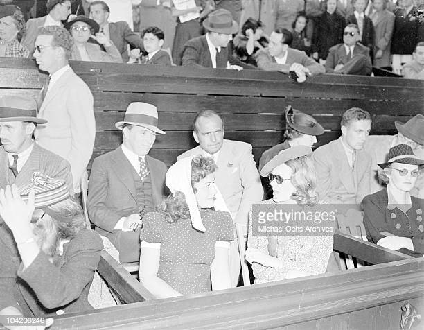 American actor Douglas Fairbanks Sr sitting next to Charlie Chaplin circa 1936 In front of them are American actress Paulette Goddard and Fairbanks'...