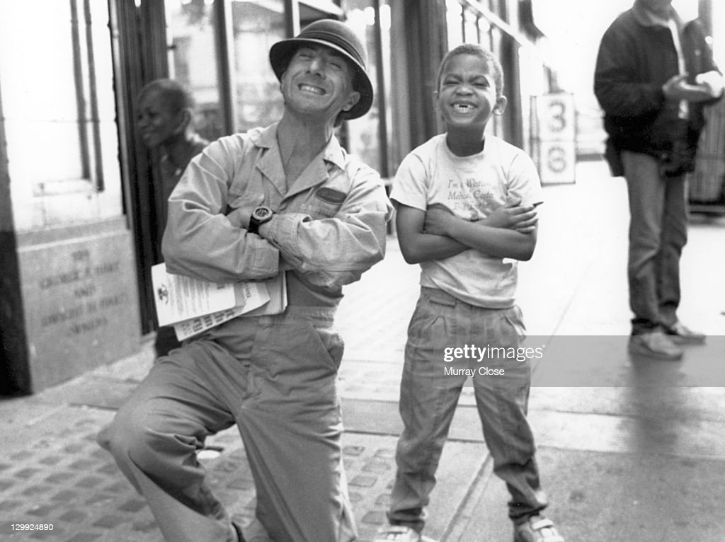 American actor Dustin Hoffman poses with a child, circa 1992.