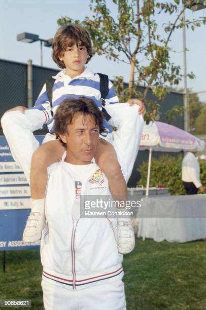 American actor Dustin Hoffman with his son Jake on his shoulders circa 1985