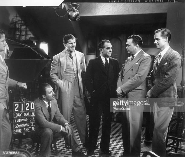 American actor Edward G Robinson talks with FBI Director J Edgar Hoover on the set of 'The Last Ganster,' Hollywood, California, September 15, 1937....