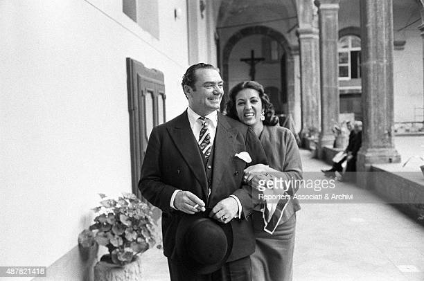 American actor Ernest Borgnine and Greekborn Italian actress Yvonne Sanson smiling during a break on the set of the film The King of Poggioreale 1961