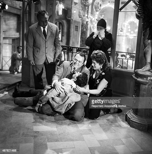 American actor Ernest Borgnine and Greekborn Italian actress Yvonne Sanson greiving over French actor Max Cartier in the film The King of Poggioreale...