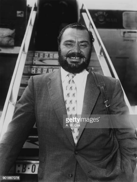 American actor Ernest Borgnine arrives at London Airport wearing a beard for his upcoming role in the film 'The Vikings' directed by Richard...