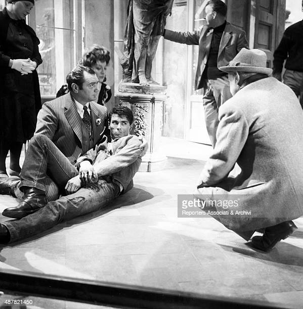 American actor Ernest Borgnine Greekborn Italian actress Yvonne Sanson and French actor Max Cartier rehearsing a scene under the watchful eye of...