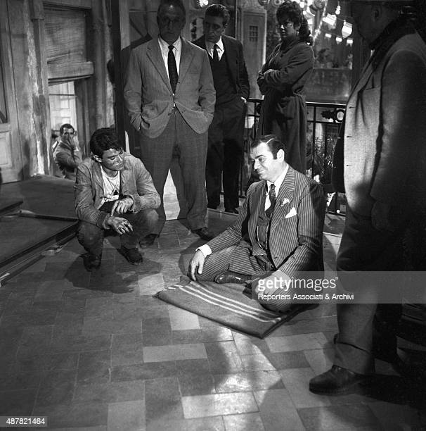 American actor Ernest Borgnine Greekborn Italian actress Yvonne Sanson French actor Max Cartier and Italian director Duilio Coletti having a break on...