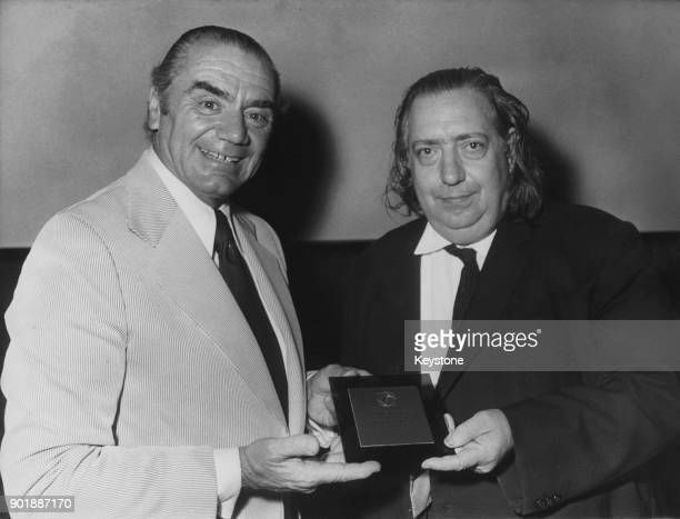 American actor Ernest Borgnine receives a prize awarded to director Robert Aldrich from French cinephile Henri Langlois in Aldrich's absence France...