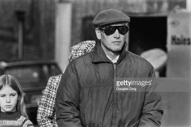 American actor film director producer and race car driver Paul Newman and walking behind him his daughter Melissa Newman UK 11th February 1977