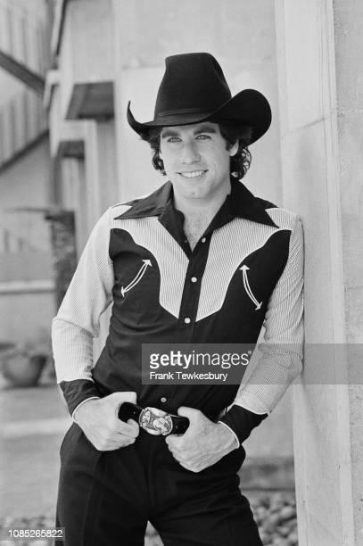 American actor, film producer, dancer, and singer John Travolta wearing a cowboy costume, UK, 3rd September 1980.