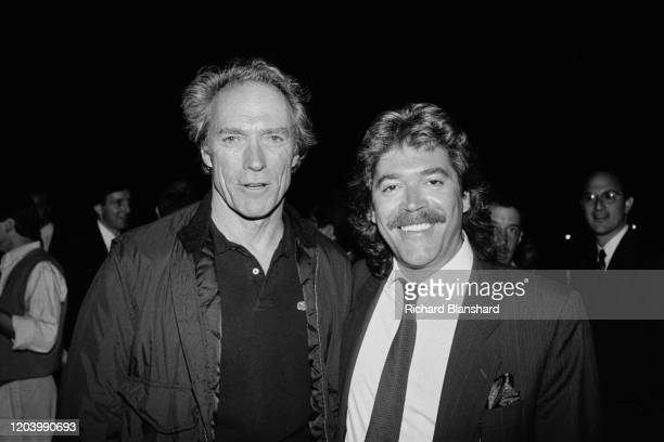 American actor filmmaker musician and politician Clint Eastwood and Lebanese film producer Mario Kassar in Cannes France 1990