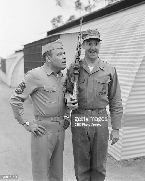American actor Frank Sutton as Sergeant Carter glares at actor and singer Jim Nabors as Gomer Pyle as the latter stands at attention and smiles on...