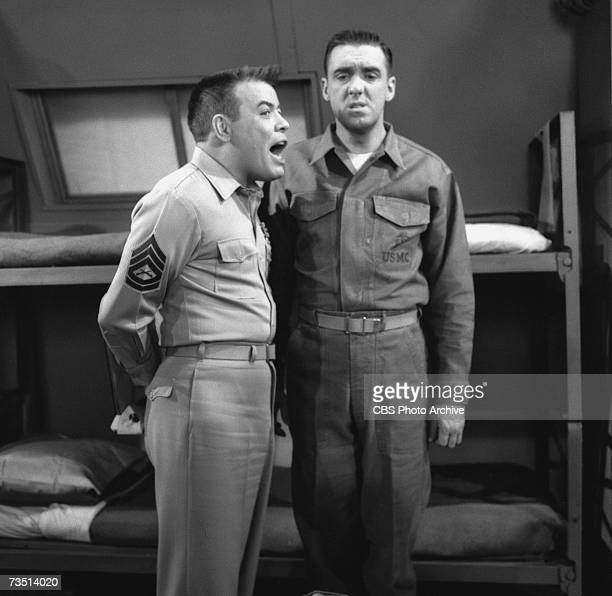 American actor Frank Sutton as Sergeant Carter shouts at actor and singer Jim Nabors as Gomer Pyle as the latter stands at attention on the set...